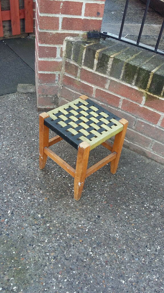 small wood stool with woven pattern seat