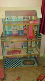 Large 4 Floor Dolls house with lift & accessories. 5 Barbie Dolls with accessories and a Barbie Car