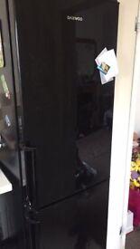 Black daewoo fridge feeezer - all working condition few scratch on side due to transportation