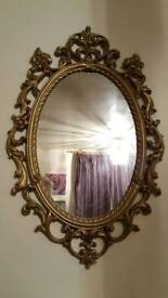 Large gilt oval mirror