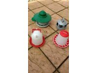 For sale various chicken feeders and drink containers.