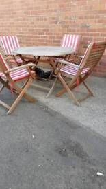 Garden table with 4 chairs and cushions