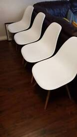 4x white plastic dining chairs