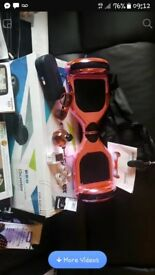 Brand new boxed hoverboard in chrome pink with led lights