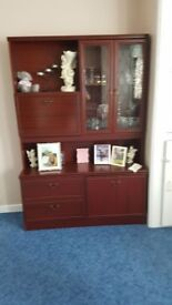 Display cabinet with glass shelves and doors