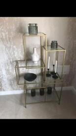 Gold and glass display shelves
