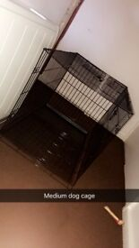 Medium sized dog cage £20 can deliver