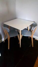 Gorgeous small white dining table 2 grey chairs