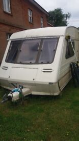 2 BERTH FLEETWOOD COLCHESTER CARAVAN WITH AWNING: RECENTLY UPDATED, READY FOR ROAD