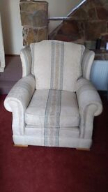 Two armchairs with wing backs.