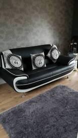 Two black and white sofas