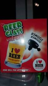 Beer glass with refill bell