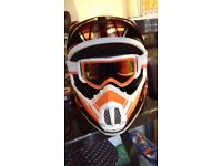 Motorcross helmet and goggles.