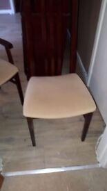 Solid mahogany dining table and 6 chairs .