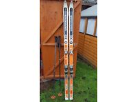 Set of skis and ski poles ROSSIGNOL