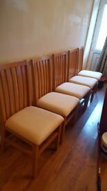 Immaculate set of six chairs and dinning table