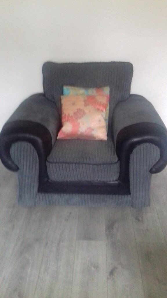 modern grey upholstered chair with black leather trim - as new !