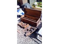 old wooden chest tool box and old wooden planes