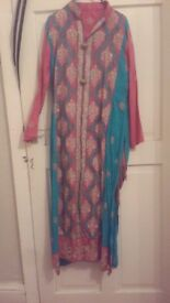 pink and light blue suit size small/meduim.worn few times selling 10£