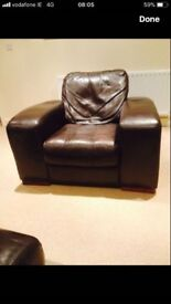 Leather three seater sofa with two armchairs and footrest