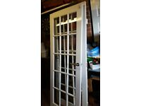 Double white glass panel doors