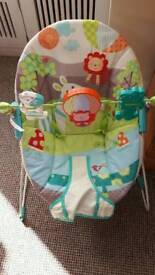 Baby chair rocker with toy bar