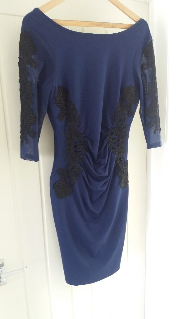 Lipsy Dress size uk 14in Southampton, HampshireGumtree - Beautiful Lipsy navy dress. Size uk 14. Lace 3/4 length sleeves. Black lace detail on arms and front. V neck back. fitted dress with gathering fabric on tummy so very flattering.Very glam dress worn once