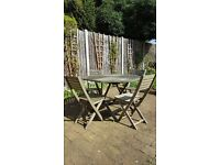 Wooden patio set - table and four chairs; used but in great condition.