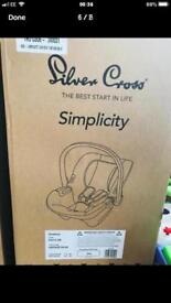 Brand new and boxed silver cross Simplicity car seat