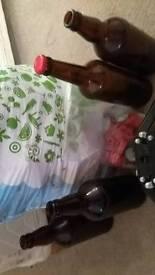 Homebrew beer bottles + capper and caps