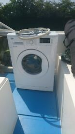 beko white freestanding washing machine wmb61432w A++, barely used.