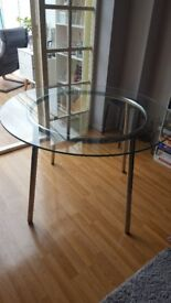 IKEA salmi round glass dining table. Good condition