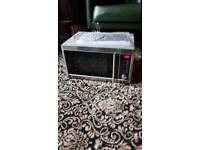 Stainless steel microwave with grill, barely used.