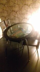 Standard glass dining table and 4 chairs