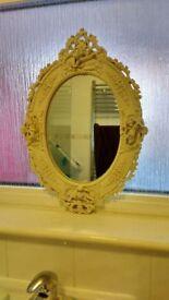 Bathroom mirror with cherubs