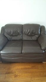 BROWN LEATHER SOFA.USED.