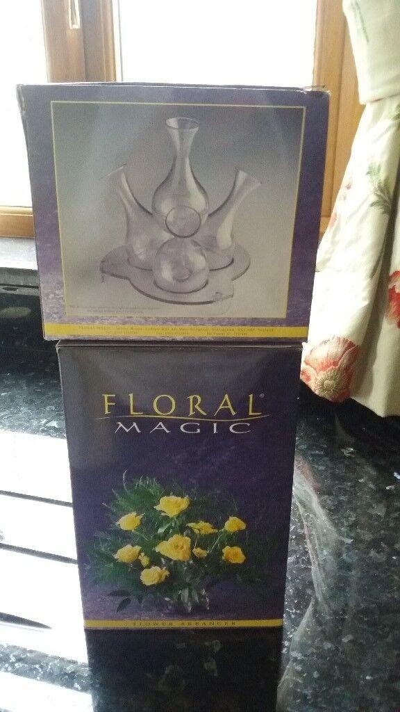 Two sets of flower arranging vases