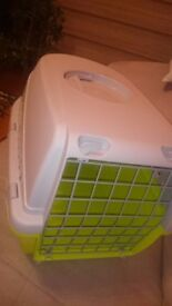 Medium solid pet carrier cage used once