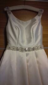 Stunning Ivory Wedding Dress. Size 10. Cleaned and immaculate. Beaded straps,waist and bow details.