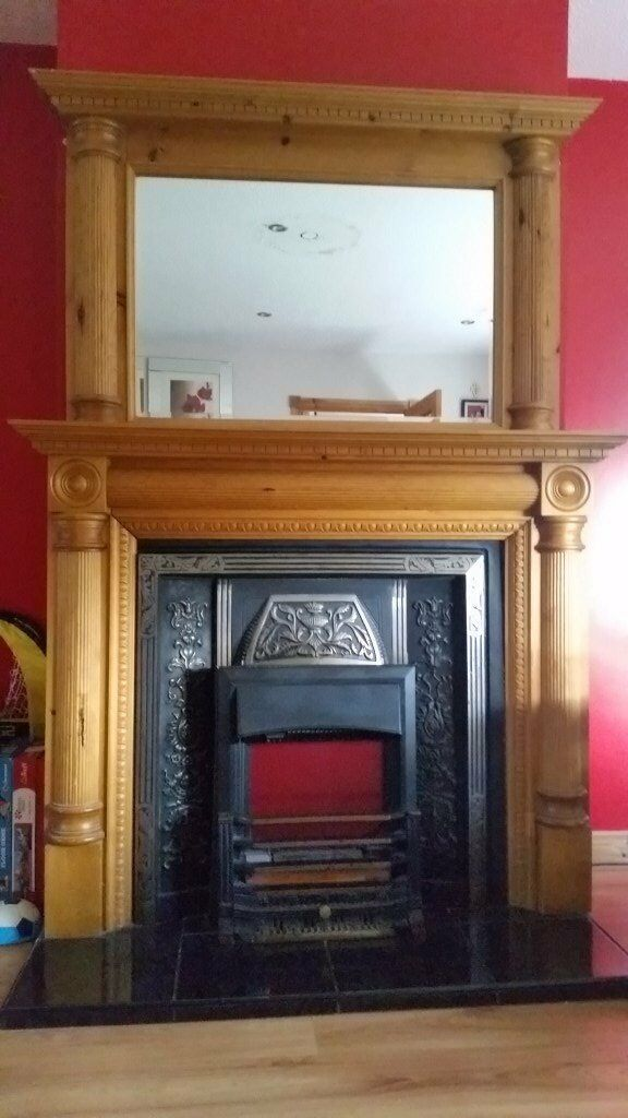 Beautifully detailed wooden fireplace, matching mirror, iron cast surround and electric fire.