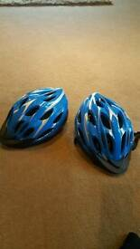 2 child's 54-58cm cycle helmets