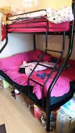Triple metal black bunk beds includes 1 double mattress. Single bed on top and double bed in bottom