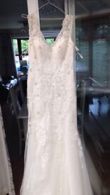 Beautiful designer wedding dress size 10-12