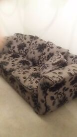 Sofa with black floral print