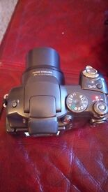Canon powershot s3 camera, bag and arena 3000 extendable tripod in good barely used condition