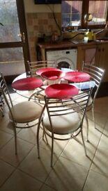 circular clear glass & chrome table 4 chrome & cream chairs