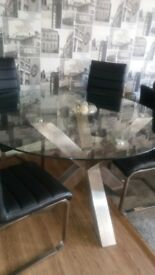 round glass top table 4 leather and chrome chairs very modern