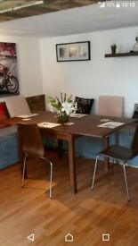 Extendable table and chairs