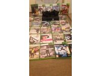 Console, microphone, 2 controllers and 29 games
