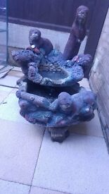 Stone otter water feature